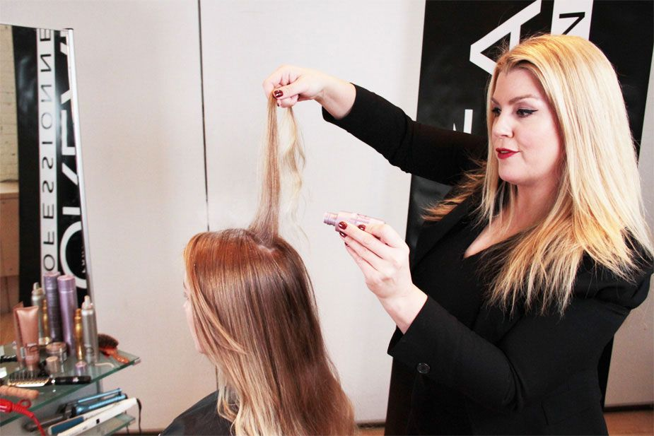 STEP 8: Pull a 1/4-inch piece of hair from the ponytail and spray with L'Oréal Professionnel Infinium 2.