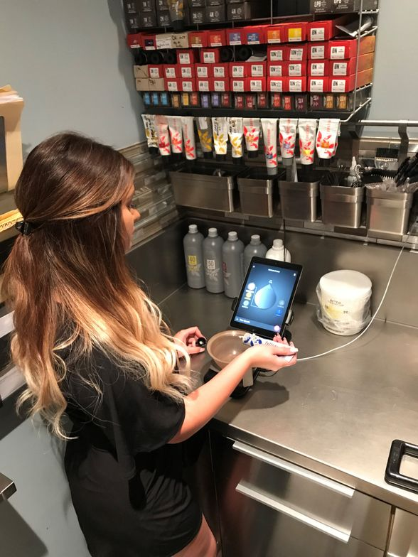At Taylor Stevens Salon and Spa in Algonquin, Illinois, colorist Taylor Swanson formulates a client's color using the color management software system Vish.