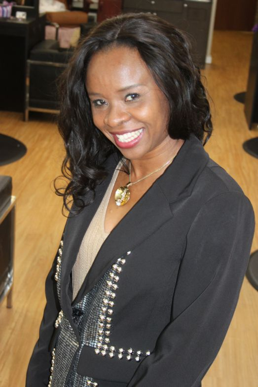 Ruth Ononogbu, owner of The Full Spectrum Hair Salon in Murphy, TX.