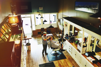 At The Lounge Barber Shop and Shave Parlor, co-owner Adam Voss, knows how to make men feel welcome—in fact several clients stop in between appointments for a cup of coffee and a chat.