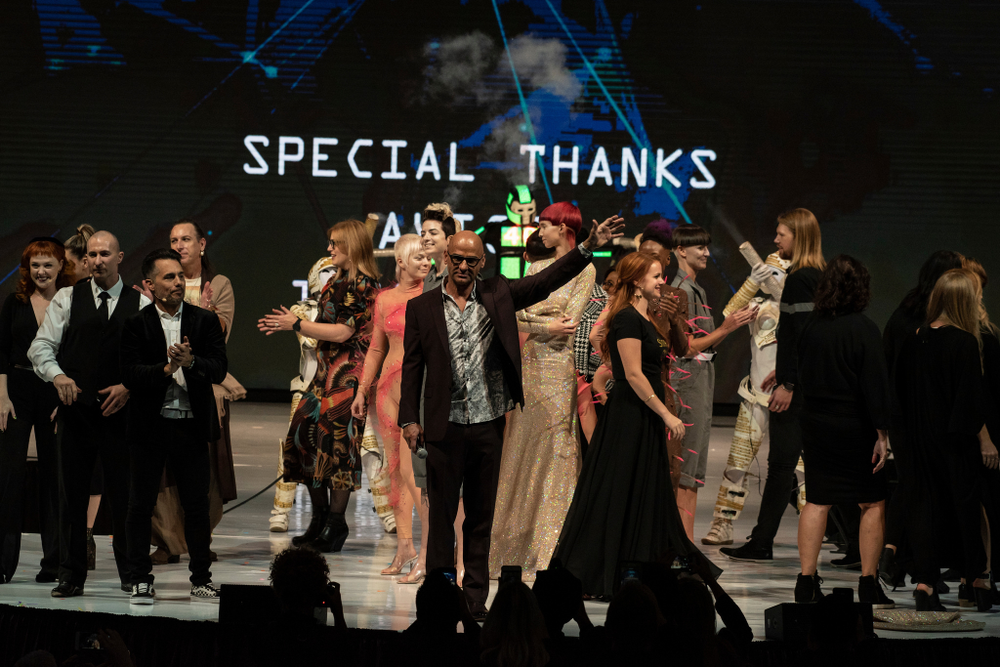 Van Council with his team and models on stage at Aveda Congress 2018.