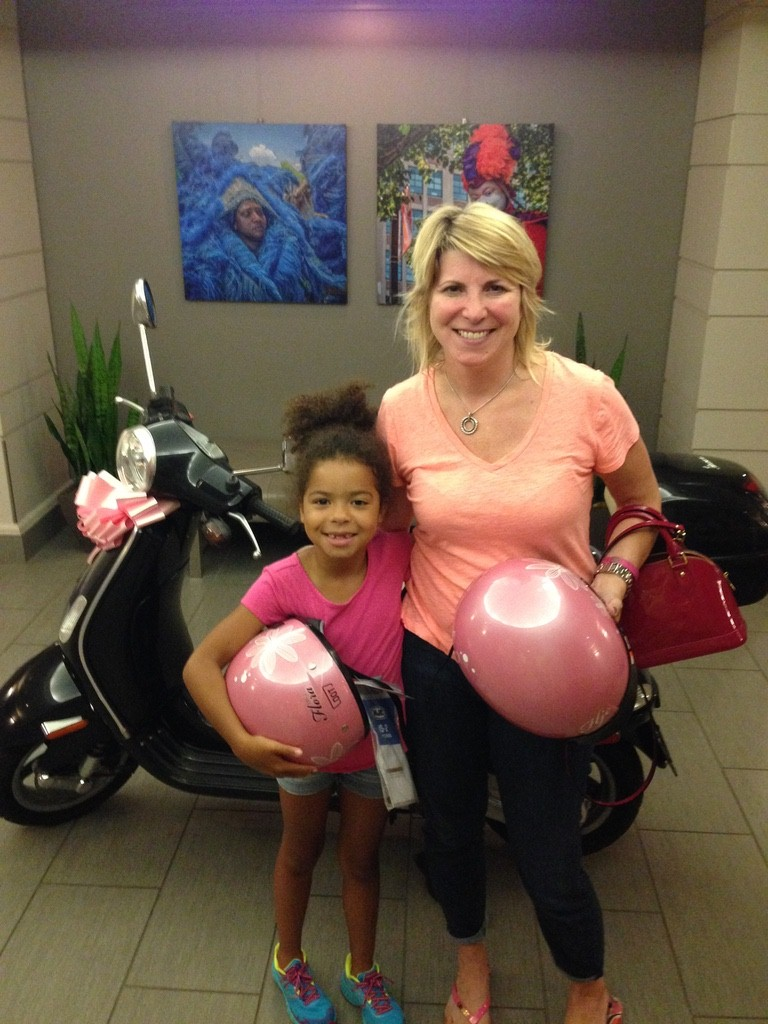 Allyson and their daughter Sydney, taking their Vespa 'Zippy' to school.