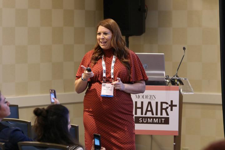 ViviscalPRO's Lauren Dudak takes attendees through some hair loss statistics.