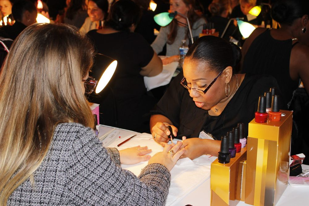 A beauty professional provides a manicure to an attendee of Welcome to Our World.