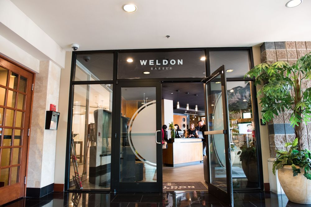The entrance to the new Weldon Barber location in Bellevue, with the J.Hilburn store to the left and the barbershop to the right.
