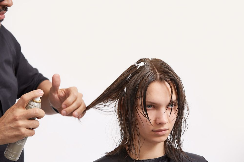 STEP 1 - Style: Apply EIMI Root Shoot on the root for lift.