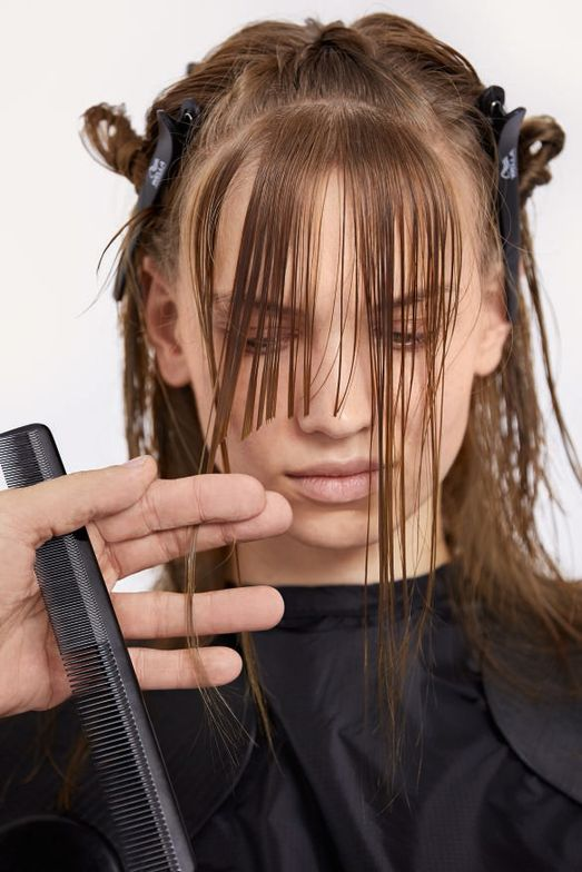 STEP 3 - Cut: Cut a rounded fringe, just falling above the tip of the nose.