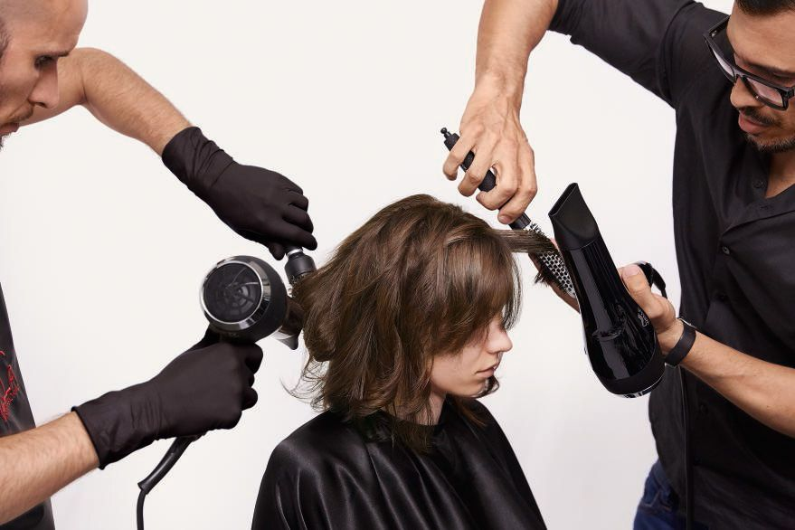 STEP 4 - Style: Accentuate the movement with a small round brush and apply EIMI Grip Cream to create the final texture.