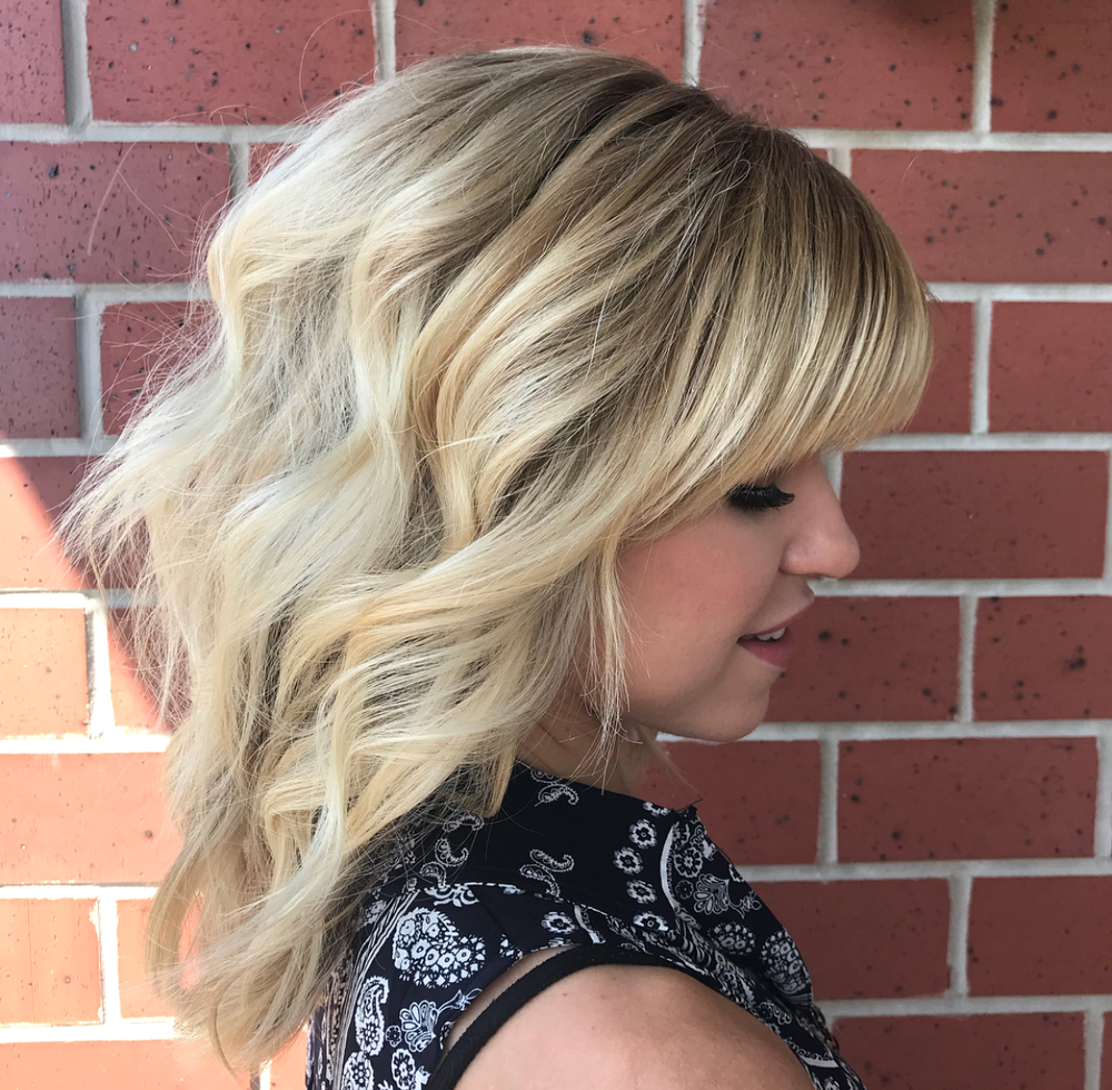 "<p><strong>A little more layering, a little  more volume. The latest lobs are giving off a shag vibe. Another quick update? Add a fringe! Hair by Whitney Bass, <a title=""Whitney Bass on Instagram"" href=""https://www.instagram.com/w.basshair/"" target=""_blank"" rel=""noopener"">@w.basshair</a></strong></p>"