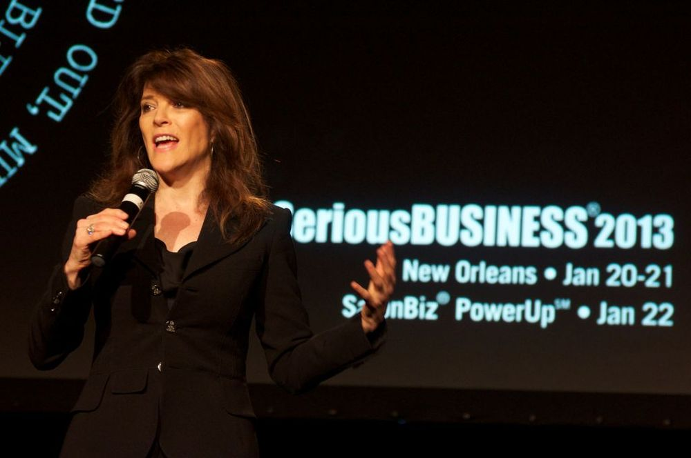 """When you are living your internal prosperity, that is when you experience external prosperity,"" said Marianne Williamson, who coached owners to shower their businesses with love. (Photo by Ross Neill)"