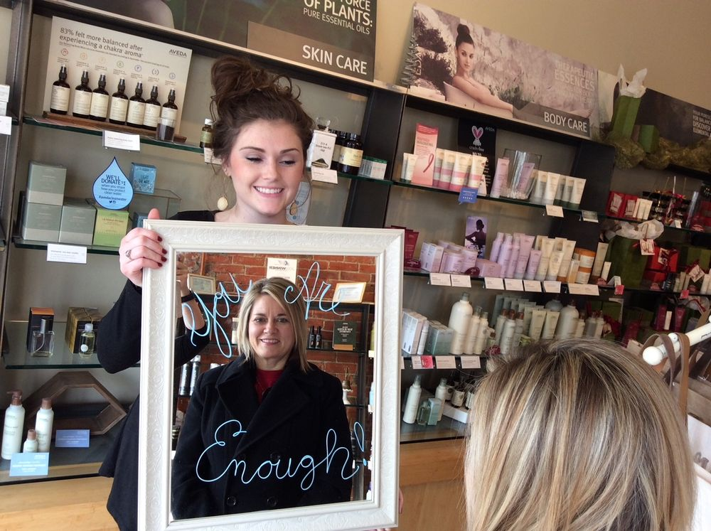 The salon shared the message of positivity with clients with this mirror, which also was incoporated into a window display.