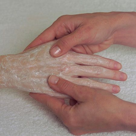 2. Apply the Exfo-Zym Caviar Hand & Foot Peel all over the hands and/or feet. Spread on the entire skin surface. Wet fingers with warm water and gently work the peel on both hands and/or feet.