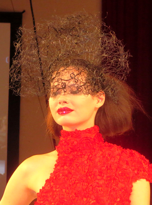 """<p>Sharon Blain's hair mask inspired by an Alexander McQueen Victoria &amp; Albert Exhibition in London. """"I was desperate to recreate it,"""" she said on stage at the Intercoiffiure America/Canada Fall Atelier in 2016.</p> <p>Hair: Sharon Blain – ICA/Goldwell … Makeup: Cheryl Eposito/Becca … Lips Pat McGrath Glitter … Fashion Stylist: Rod Novoa. </p>"""