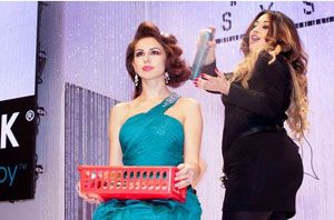 Anna Cantu, lead artist at ABS, styles onstage with BioSilk Volumizing Therapy Hair Spray.