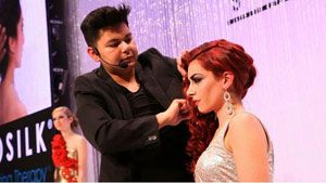 JUlian Macias finishes the models curls with CHI Keratin Silk Infusion.
