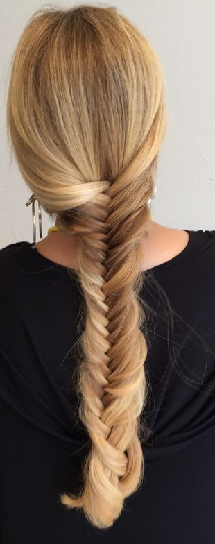 A gorgeous fishtail braid by Adam Winwood created in less than 3 minutes.