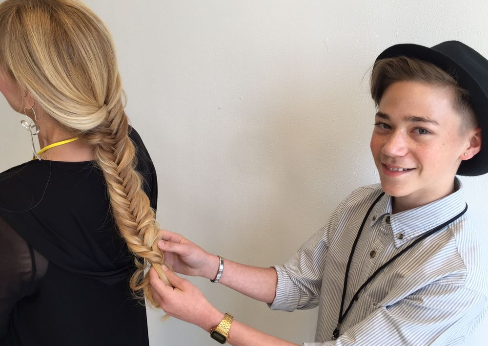 Adam Winwood puts the finishing touches on a fishtail braid.