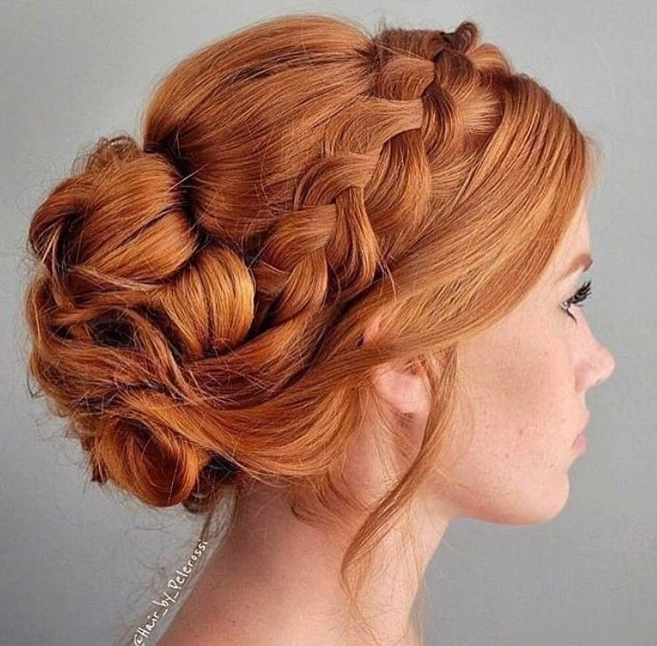This beautiful red braided updo by @alex_haircraft brightens our day.