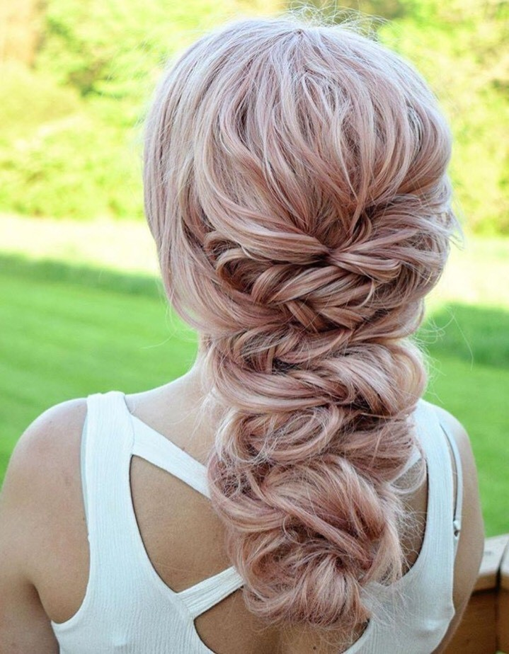 This twisted braid by Artist Connective member @beautybyhaleygarber is giving us major wedding hair goals.