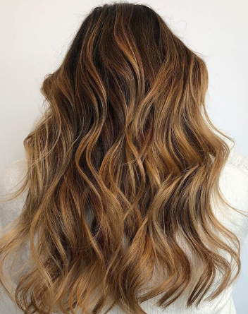 """My favorite part of winter is darkening and warming up my balayaged beauties,"" Alison Valsamis says. ""I hand painted using L'anza Clay Decolorizer and 40 volume, utilizing Trauma Treatment for extra protection and strength."" Alison Valsamis (@braidedandblonde)"