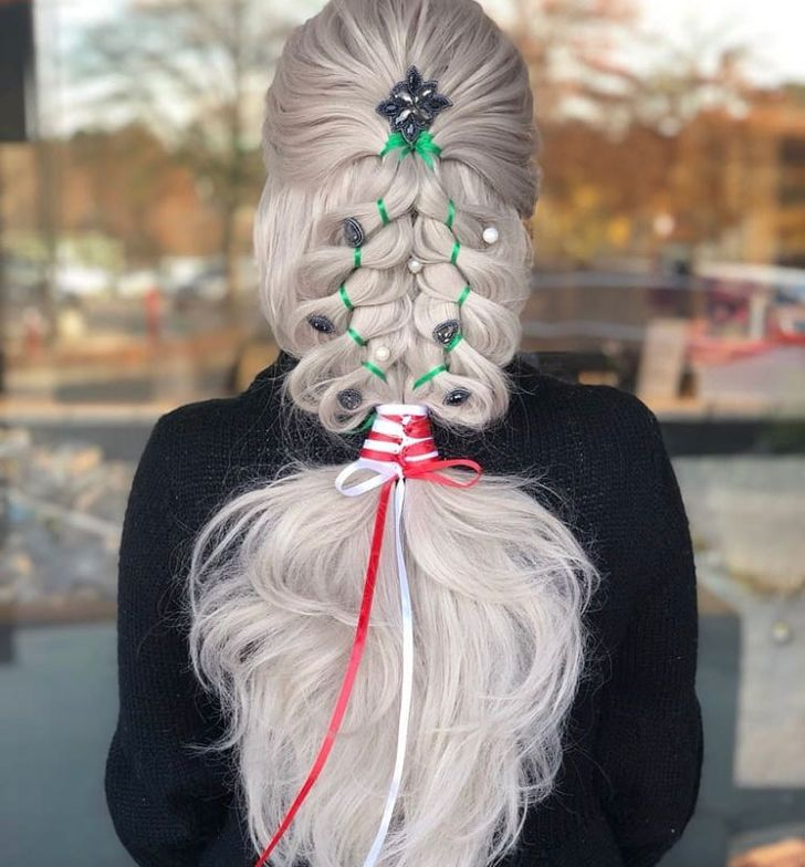 "Accidental Christmas Tree. ""T<span title=""Edited"">his unique upstyle was done using a string braid at the top, following into a 4 strand braid using a ribbon on the left and one on the right. Finished with a red and white Chinese ladder ribbon braid. Used <a class=""notranslate"" href=""https://www.instagram.com/sexyhair/"">@sexyhair</a> <a href=""https://www.instagram.com/explore/tags/bigsexyhair/"">#bigsexyhair</a> <a href=""https://www.instagram.com/explore/tags/powderplaylite/"">#powderplaylite</a> to expand my 4 strand braids. When I stepped away from it, it looked like a Christmas tree. So I went with it. Then I decorated it with <a class=""notranslate"" href=""https://www.instagram.com/pinkpewter/"">@pinkpewter</a>.""</span>"