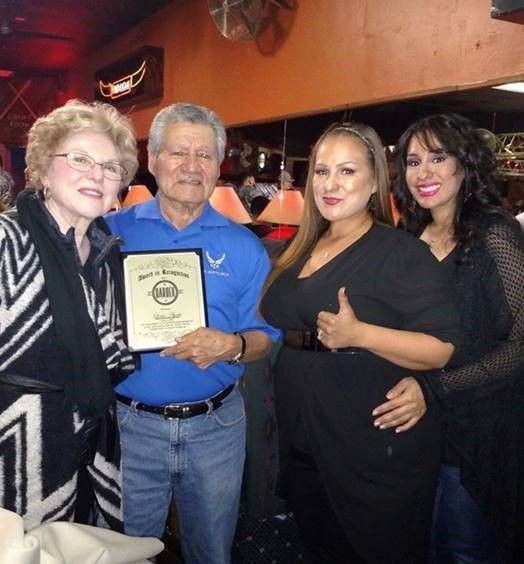 """<p><strong><em></em></strong></p> <p><strong><em>Angela Henning, along with her sister and Great Aunt present her Great Uncle Louis Ayala </em></strong></p> <p><strong><em>an """"Award of Recognition"""" for being a pioneer to so many people in the Dallas/Fort Worth area.</em></strong></p>"""