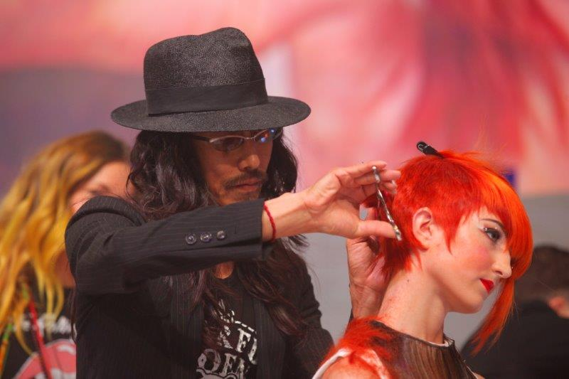 Takashi at work on stage with Paul Mitchell.
