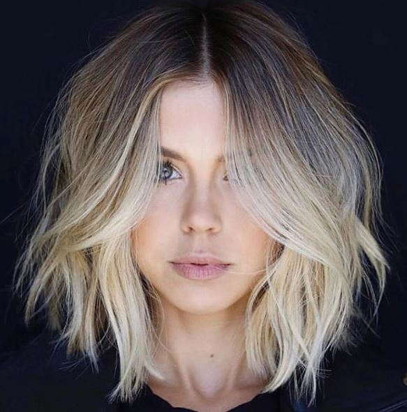 The mother of all lobs. This collaboration went crazy on Instagram, and we can see why. The amazing color work combined with such a flattering shape gave many clients and stylists alike major hair envy.