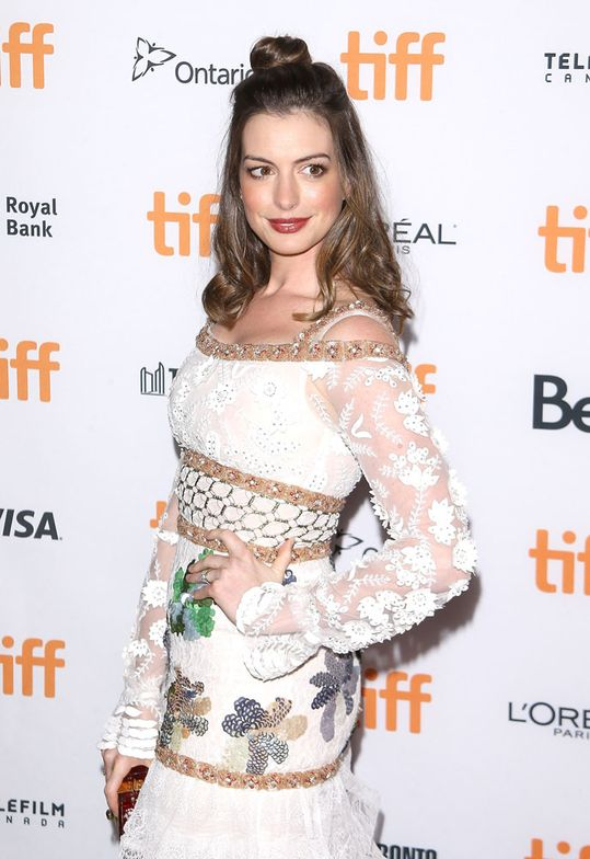 "Anne Hathaway arrives at the 2016 Toronto International Film Festival ""Colossal"" premiere held at Ryerson Theatre on September 9, 2016 in Toronto, Canada. Hair by Anh Co Tran for Flow Hair Care."