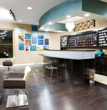 """Aqua at the Georgia Center Salon and Spa Evans, Georgia aquasalon-spa.com Owner: Sandy Maddox Salon Established: August 2008 Salon style: Modern, sleek, innovative <Br>Square footage: 5,000 Styling stations: 12 Treatment rooms: 7 Equipment: Takara Belmont, Salon Ambience Furniture: Columbia Beauty Supply, """"L & E Inc"""" <Br>Total design investment: $441,200 Top retail lines: Redken, Pureology, Esuchen Design: Sandy Maddox <Br>Architect: Chris Booker"""