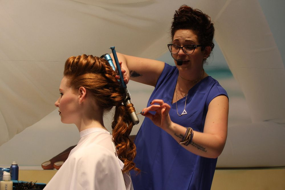 """The ponytail was carefully curled using a 1"""" curling iron."""