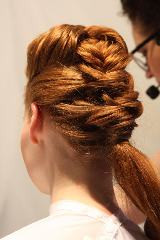 Here, the two-sranded French fishtail braid at the top of the head was deconstructed.