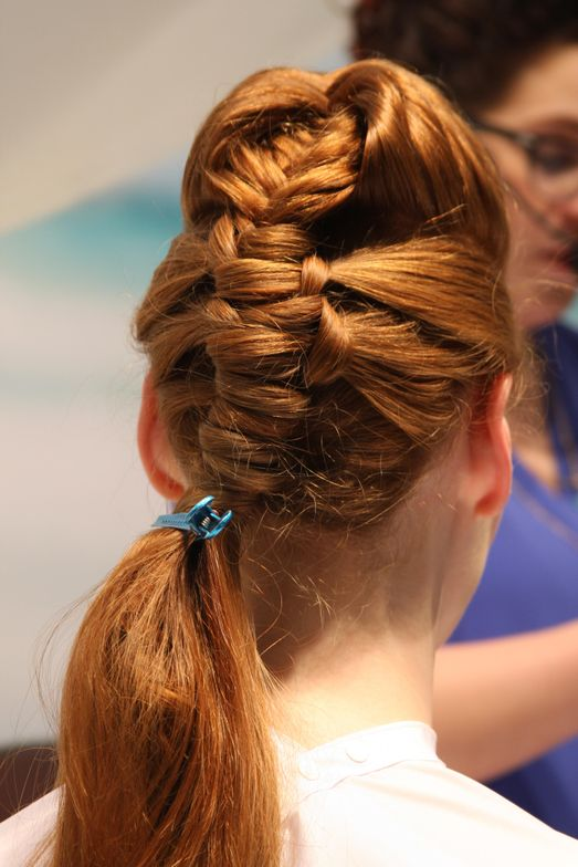 To start the look, a two-stranded French fishtail braid was created at the crown of the head.