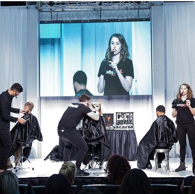 Ashley Holtz leads barbering demos on stage atthe World's Fair of Cosmetics Arts and Sciences inAustin, Texas.