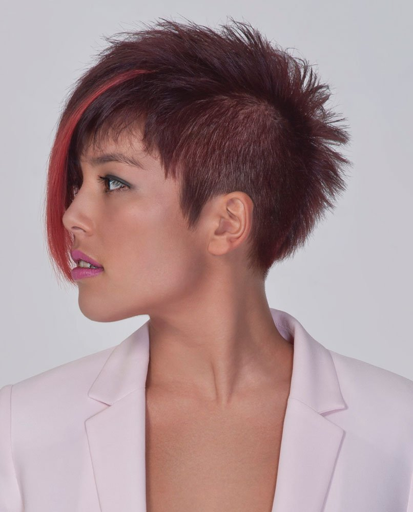 Diandra is wearing an asymmetrical pixie style with a heavy fringe enhanced by adding Vomor extensions.