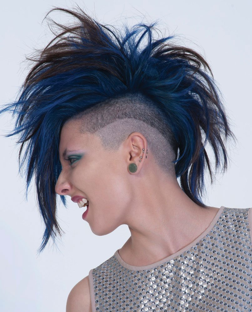 For Cierra, an undercut with curved lines created contrast with a heavily textured Mohawk.