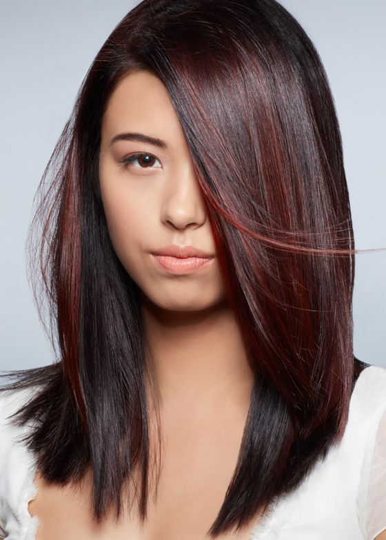 """<span style=""""font-size: 10.000000pt; font-family: 'Calibri';"""">""""Soft panels of cool raspberry reds intertwined through the darker hues offer subtle glimpses of excitement as the hair moves,"""" Black says. </span>"""
