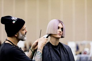Jon Reyman defines the shape before taking the stage at Aveda Congress, 2019.