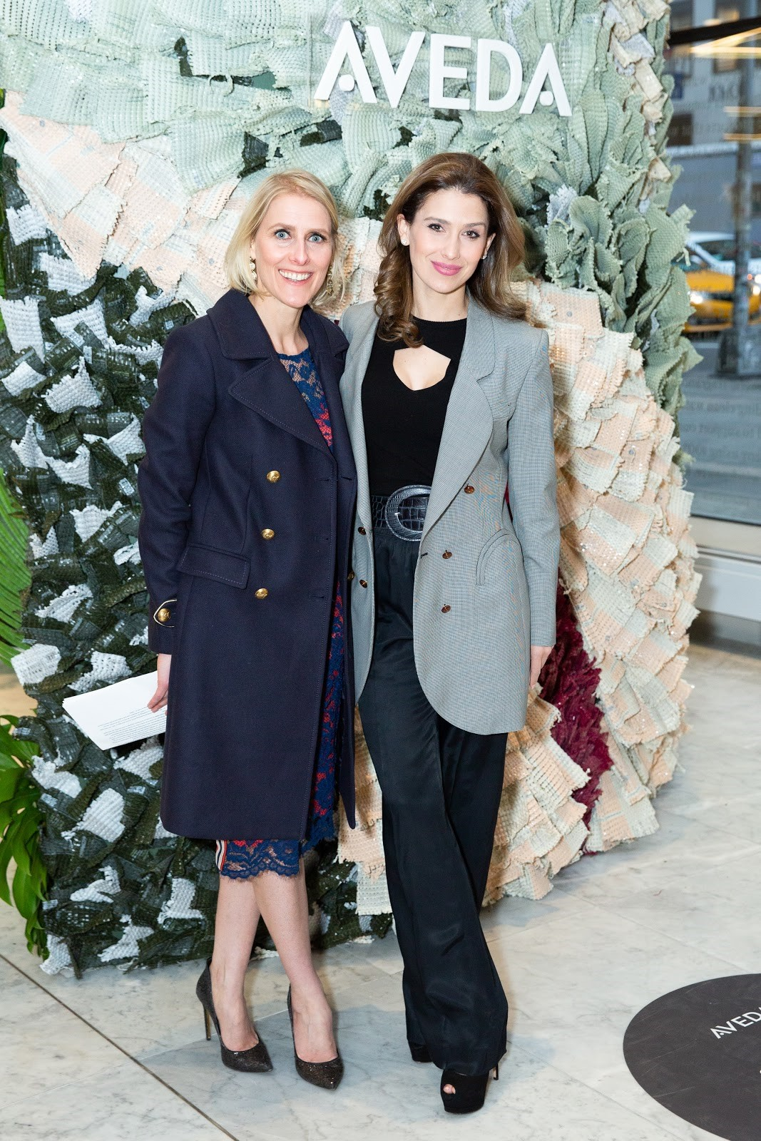 l-to-r: Aveda Global General Manager Barbara De Laere with Hilaria Baldwin, unveiling Aveda sustainability installation at FIT in New York City