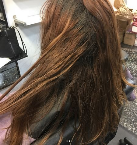 BEFORE: This client came in with 2-3 inches of new growth and faded permanent red color on the ends.