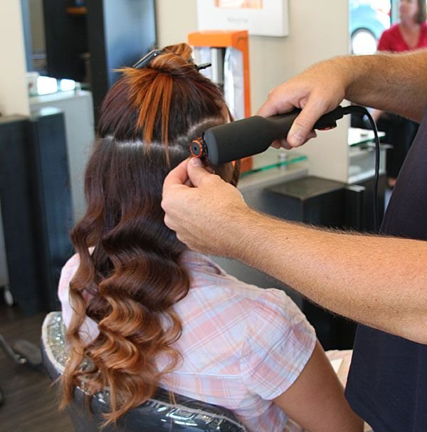 Continue this process throughout the head making sure to take smaller sections for thicker hair and larger sections for thinner hair.