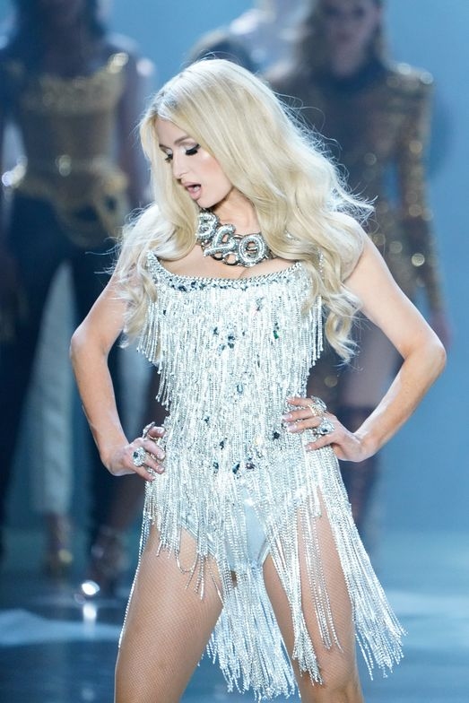 Paris Hilton at The Blonds F/W 2019. Hair by Kevin Hughes (Moroccanoil), manicure by Shelena Robinson (CND) and makeup by Kabuki (MAC) at The Blonds F/W 2019.