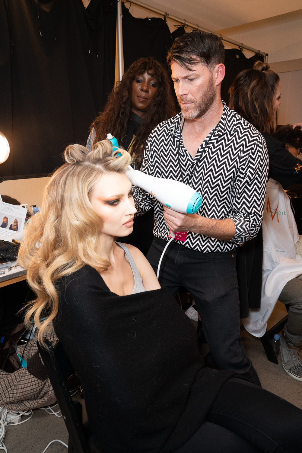 Kevin Hughes, Moroccanoil Artistic Director, preps the hair for The Blonds F/W 2019.