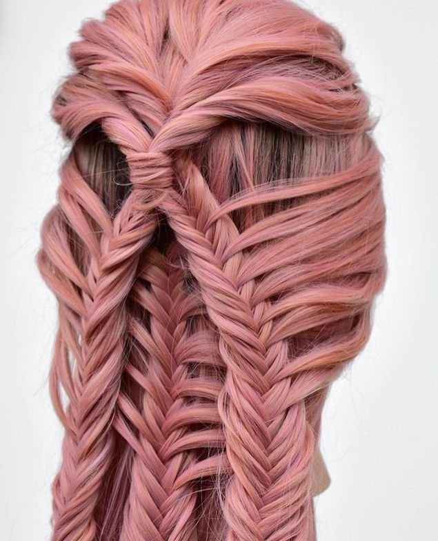 @hairbykatied's intense braiding talent showcased on a wig.