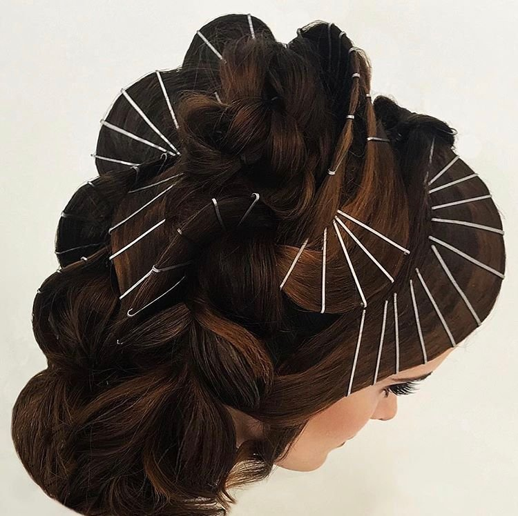 @updoguru contrasts dark hair with reflective pins.