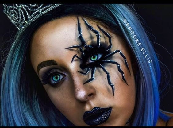This look screams spider queen and challenges the fearful.