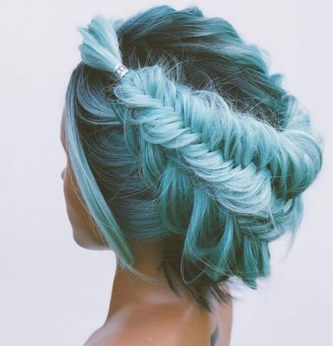 We love pretty much every updo this artist creates, but this blue one has a special place in our hearts.