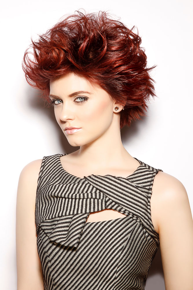 """Broken lines in a geometric hair cut make the work more feminine and less androgynous,"" says Codner.  Combining texture with the balayage color technique adds to dimension and contrasts in the styles in the Prism collection."