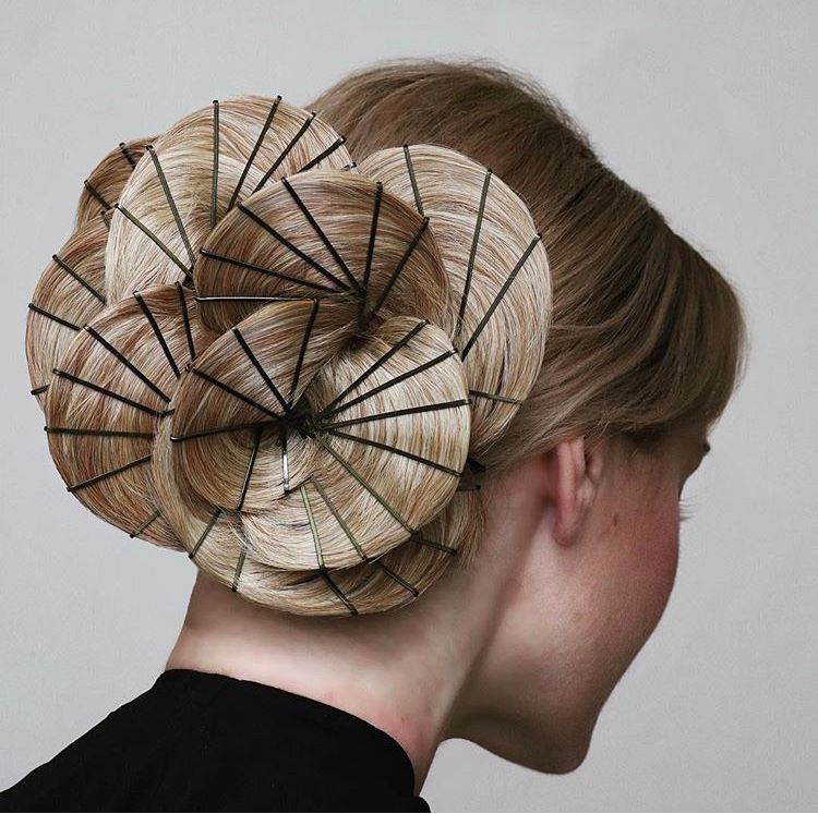 Casey Powell, the @updoguru, shares her signature technique in this pinwheel-inspired style.