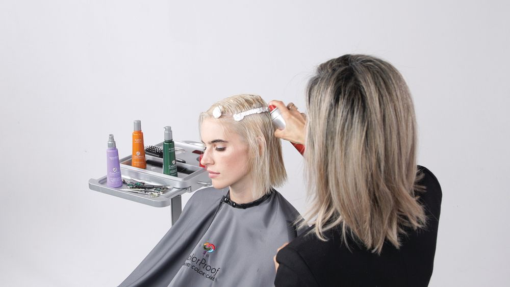STEP 2: Apply LiftIt Mousse Color Protect Root Boost directly to the root area section-by-section throughout the hair, combing it down to distribute product.